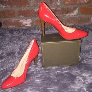 Calvin Klein orange-red stacked heel pumps